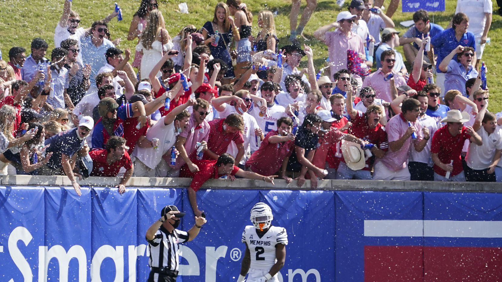 SMU fans in the student section on the hill cheer after a touchdown by wide receiver Reggie Roberson Jr. as Memphis defensive back T.J. Carter (2) turns away during the first half of an NCAA football game at Ford Stadium on Saturday, Oct. 3, 2020, in Dallas. (Smiley N. Pool/The Dallas Morning News)
