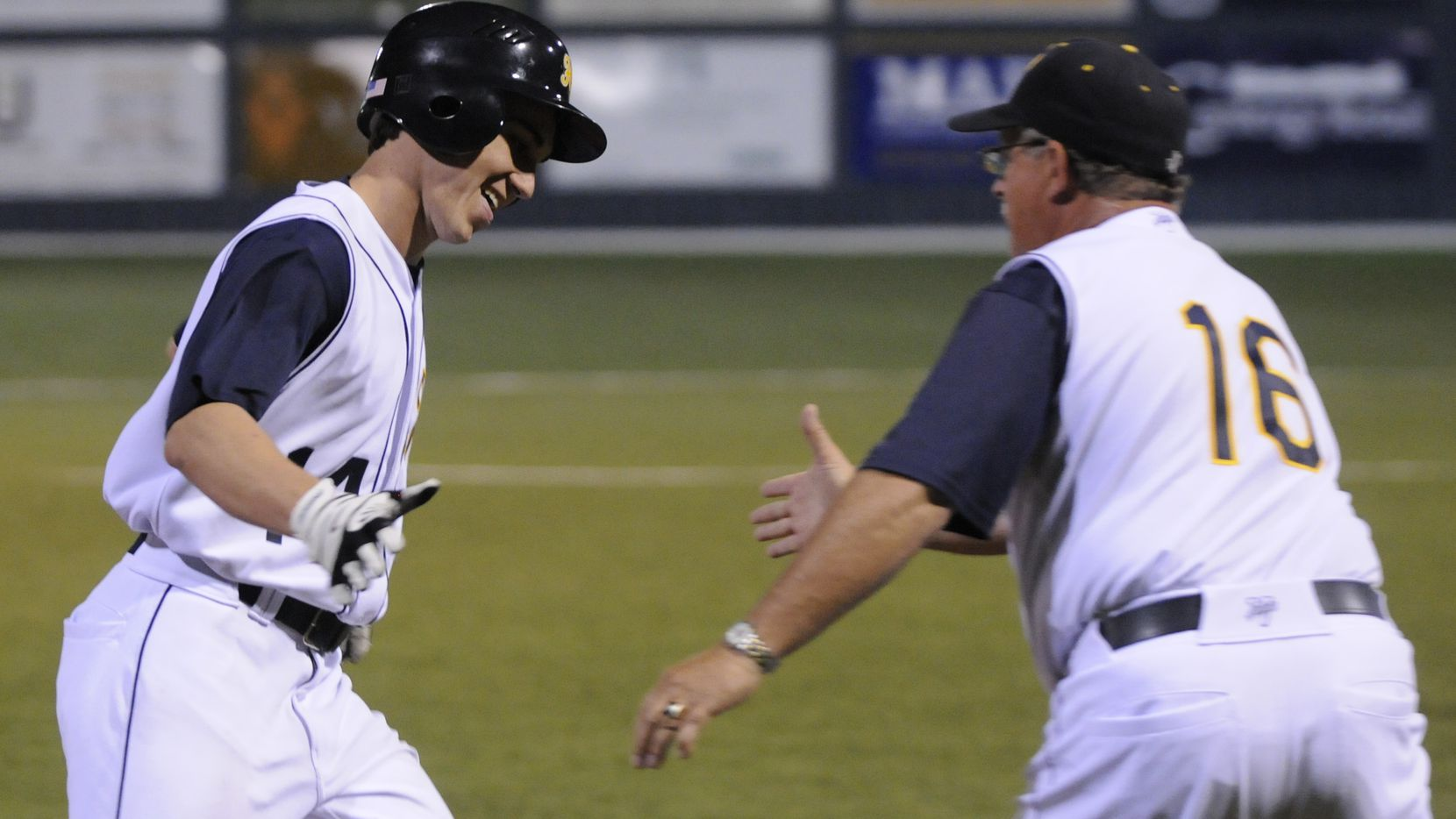 Highland Park's Jake Howeth, left, extends a hand to head baseball coach Fred Oliver after hitting a home run against Wylie High School.