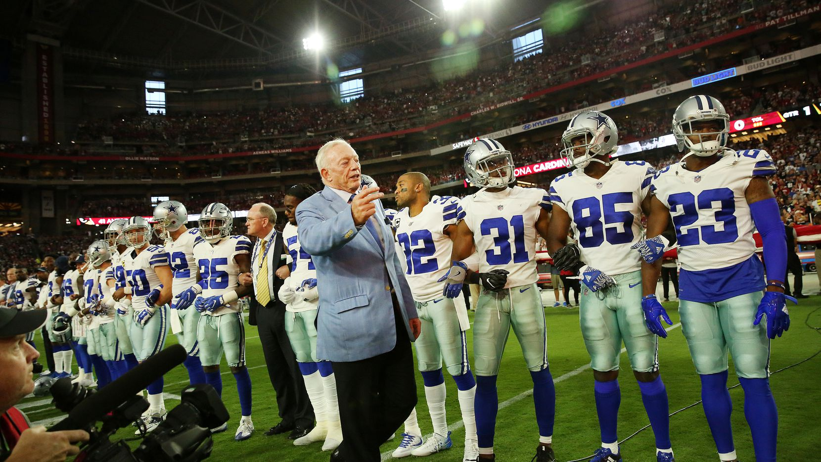 Dallas Cowboys owner Jerry Jones ushered photographers back to their position as stadium personnel tried to remove the media before the Cowboys took a knee before the playing of the United States National Anthem before a National Football League game between the Dallas Cowboys and the Arizona Cardinals at University of Phoenix Stadium in Glendale, Arizona on Monday September 25, 2017.