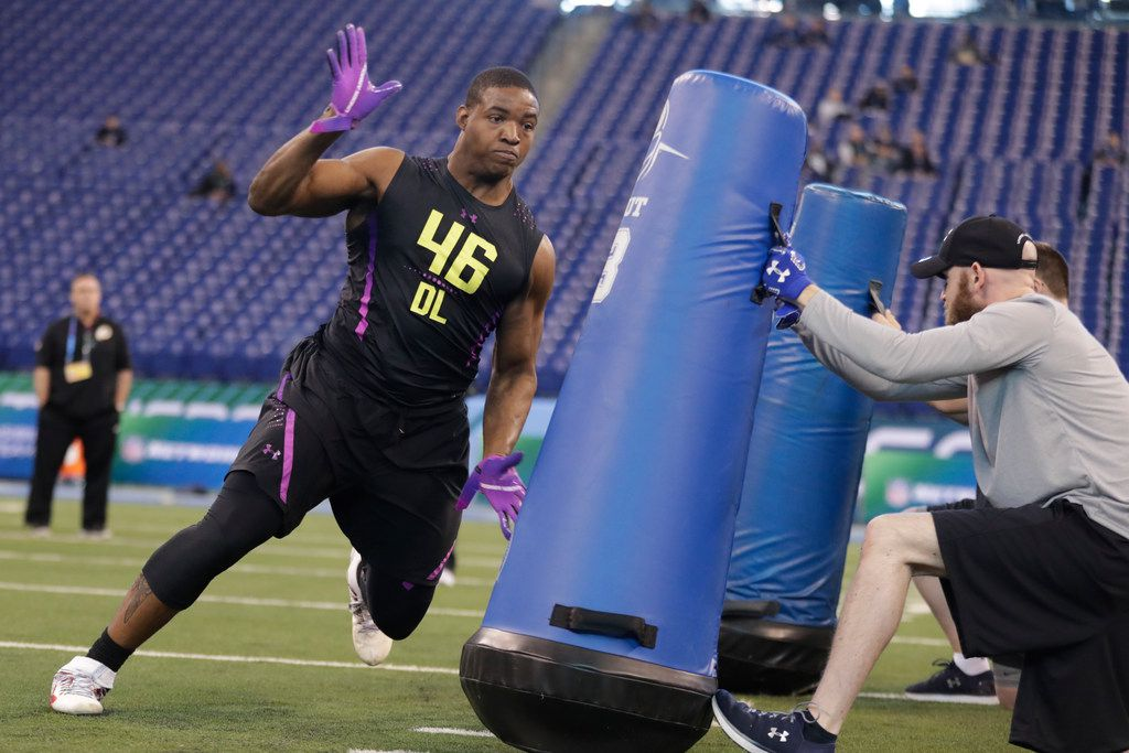 Mississippi defensive lineman Breeland Speaks runs a drill at the NFL football scouting combine in Indianapolis, Sunday, March 4, 2018.