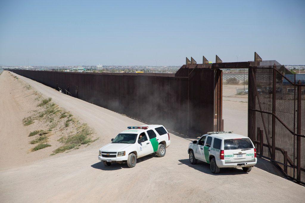 Border Patrol agents park beside the wall between El Paso and Ciudad Juarez, Mexico.