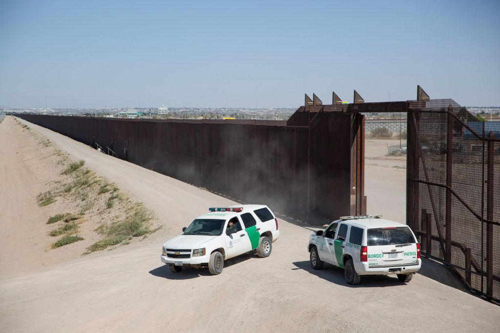 Border Patrol agents along the wall between El Paso, Texas, and Ciudad Juarez, Mexico. (Ivan Pierre Aguirre/The New York Times)