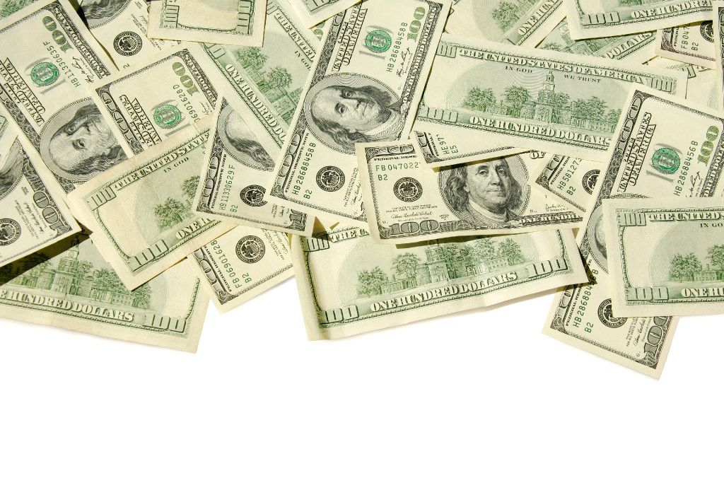 Photo illustration of money Lot's of US $100 bills on a white background (clipping path is included). View from above.