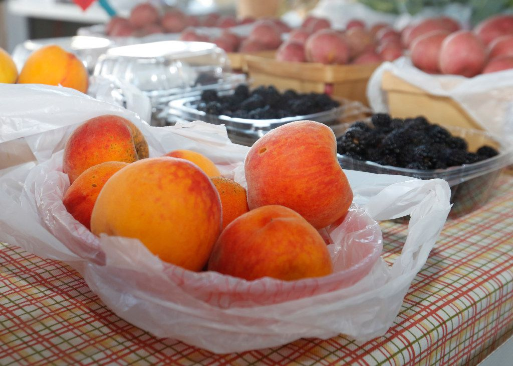 The Williams Farm booth in The Shed at Dallas Farmers Market offered peaches to market shoppers. This year, North Texas peach orchards are expected to outperform Hill Country peach orchards.