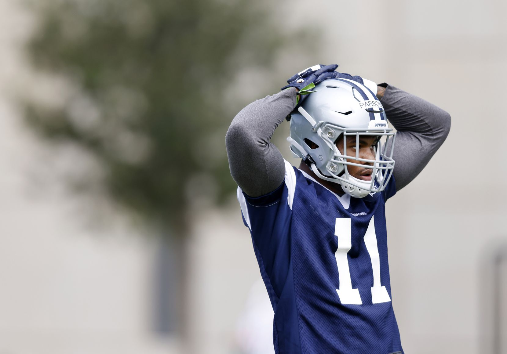 Dallas Cowboys rookie linebacker Micah Parsons (11) takes a breather during rookie minicamp at the The Star in Frisco, Texas, Friday, May 14, 2021. (Tom Fox/The Dallas Morning News)