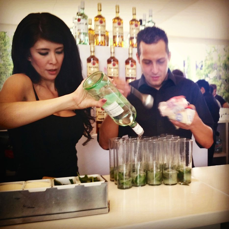 The Bacardi crew, cranking out an assembly line of mojitos before the walking tour.