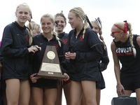 Members of the Lucas Lovejoy girls cross country team react after being presented the Regional Championship trophy. The Class 5A Region ll cross country meet was held inside Lynn Creek Park at Joe Pool Lake in Grand Prairie on October 26, 2021. (Steve Hamm/ Special Contributor)