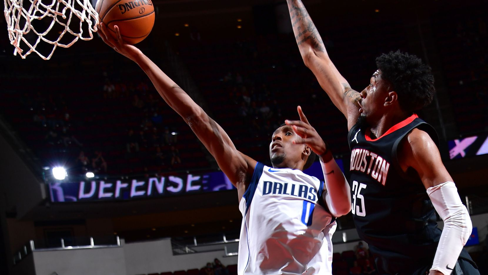 HOUSTON, TX - JANUARY 4: Josh Richardson #0 of the Dallas Mavericks shoots the ball against forward Christian Wood of the Houston Rockets on January 4, 2021 at the Toyota Center in Houston, Texas.
