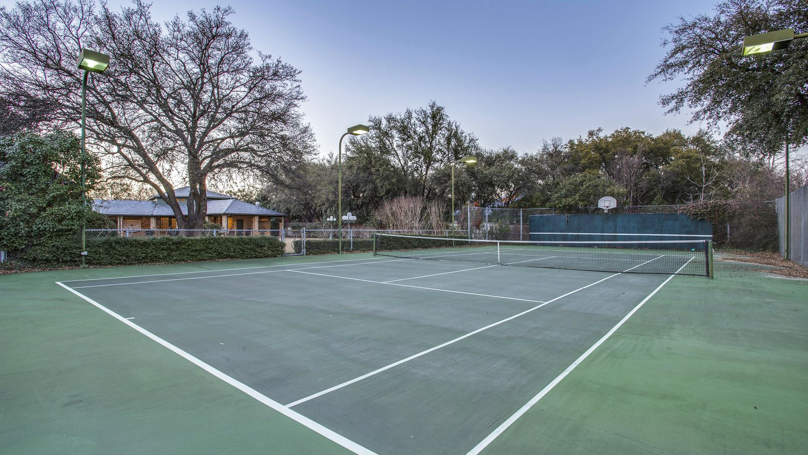 Offered for $2,749,900, the estate at 5609 Willow Bend Court features six bedrooms, a tennis court, guest house and renovated apartment.