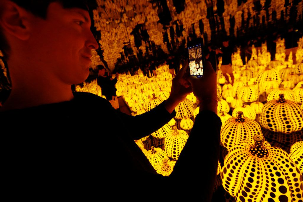 Todd Joyce takes photos in the Yayoi Kusama installation 'All the Eternal Love I Have for the Pumpkins' at the Dallas Museum of Art.