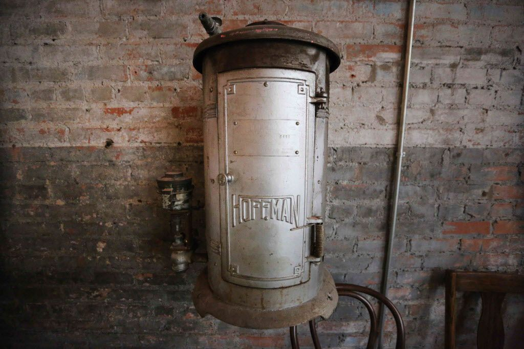 A vintage water heater is mounted on the wall in the foyer of the new restaurant, Filament, at 2626 Main Street in Deep Ellum in Dallas, photographed on Tuesday, December 1, 2015. (Louis DeLuca/The Dallas Morning News)