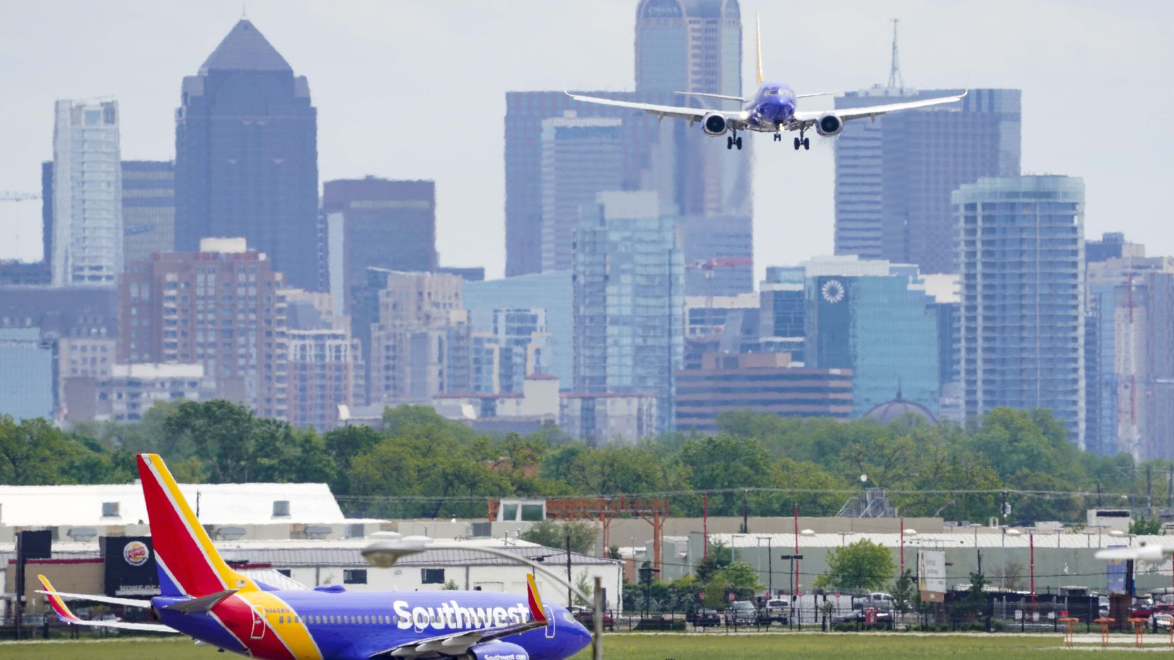 A Southwest Airlines 737 lands at Dallas Love Field on Tuesday, April 14, 2020, in Dallas.  (Smiley N. Pool/The Dallas Morning News)