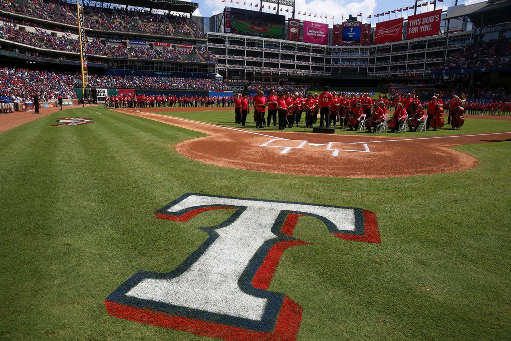 The Forth Worth Symphony Orchestra prepare to perform the National Anthem before a the Rangers final game on Sunday, September 29, 2019 at Globe Life Park in Arlington, Texas.
