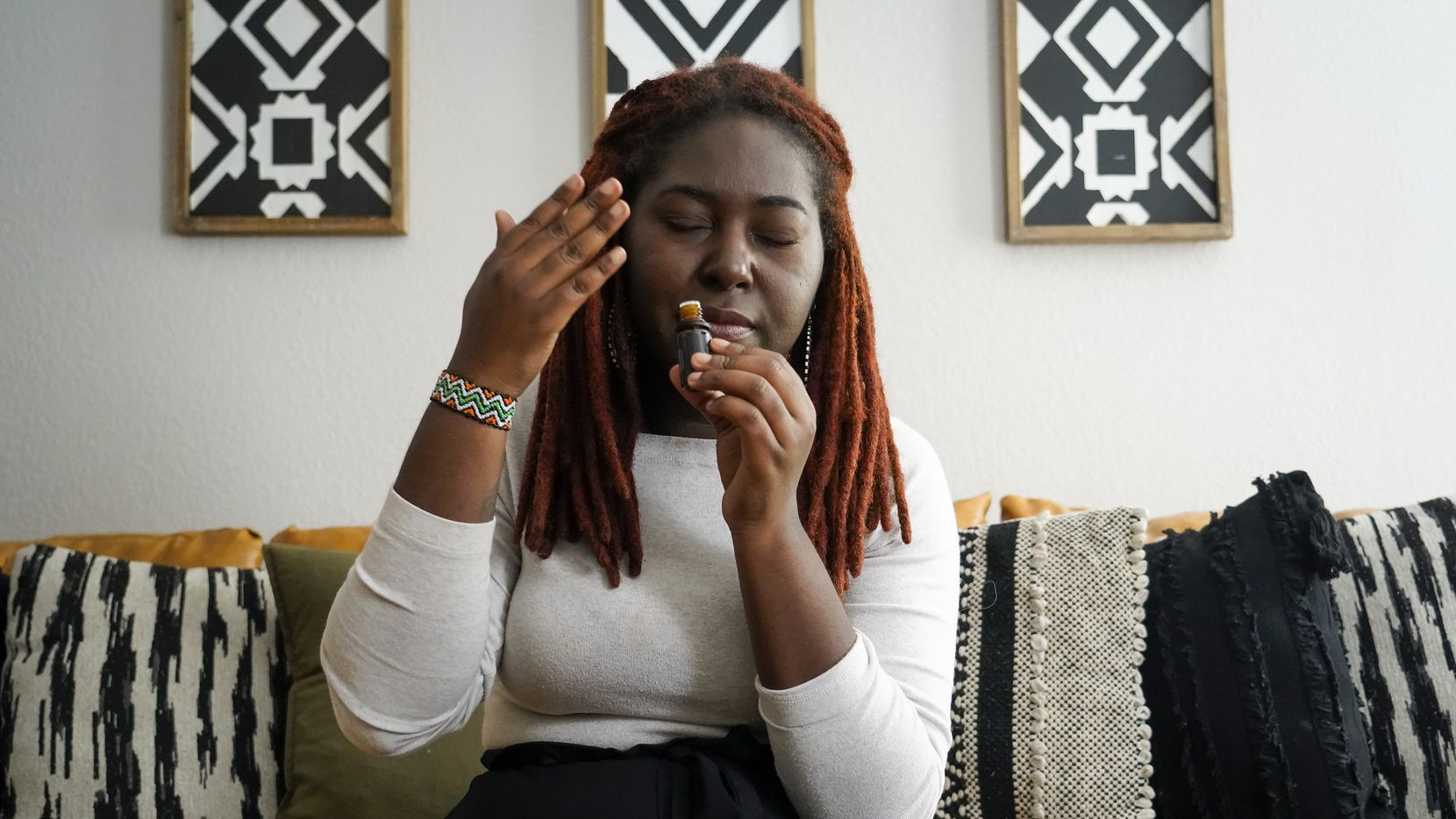 Tiffani Hutton practices smell training, a form of physical therapy for the nose. She inhales the aroma from essential oils in an effort to beat parosmia, a smell distortion triggered by COVID-19.