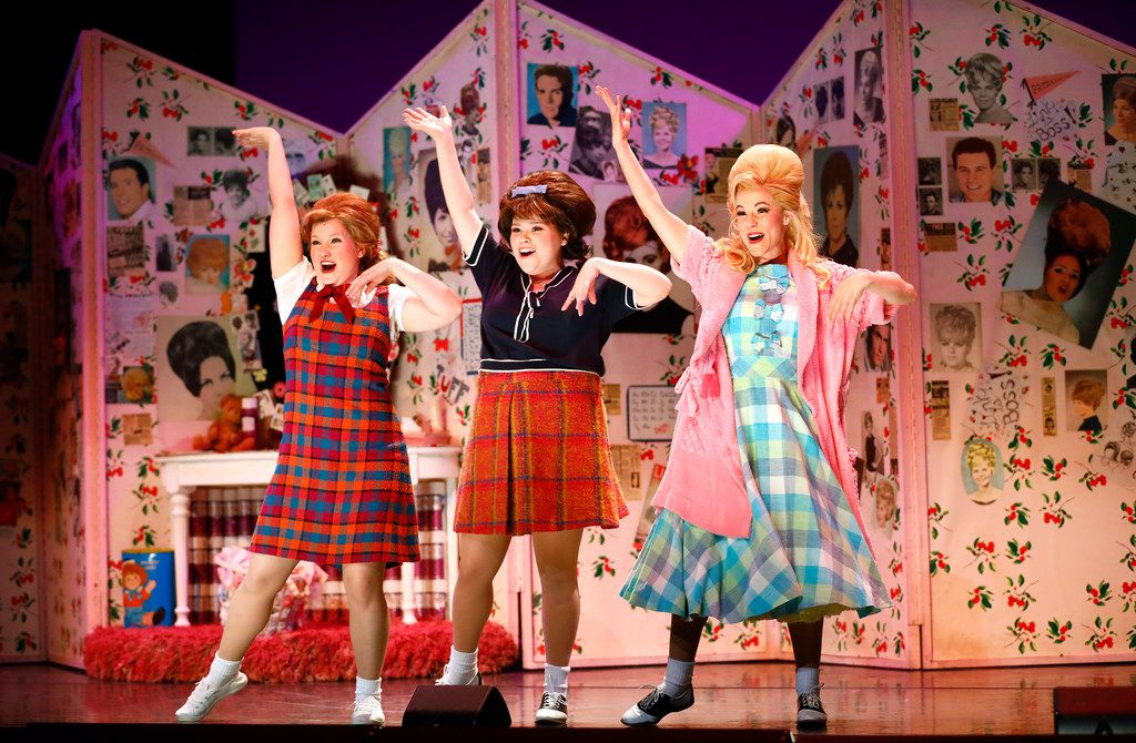 Taylor O'Toole playing Penny Pingleton (left), Michelle Dowdy as Tracy Turnblad and Deanna Ott as Amber Von Tussle perform a scene during final dress rehearsal of Hairspray, produced by Dallas Theater Center at the Winspear Opera House in Dallas.