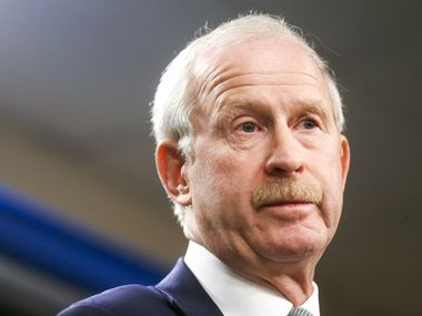 """Dallas Stars General manager Jim Nill gives remarks during a press conference announcing Assistant coach Rick Bowness as the new Dallas Stars interim head coach on Tuesday, December 10, 2019 at American Airline Center in Dallas. On Tuesday Dallas Stars General manager Jim Nill announced that the team had fired head coach Jim Montgomery for """"unprofessional conduct"""". (Shaban Athuman/Staff Photographer)"""