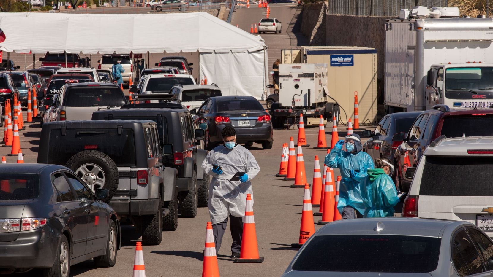 Lines at a COVID-19 testing cite at UTEP in El Paso. The city has been reporting high numbers of positive cases, and local hospitals were close to capacity on Oct. 28, 2020.