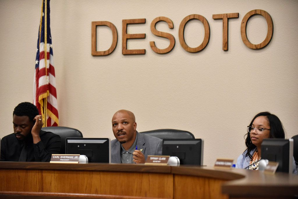 DeSoto ISD president Carl Sherman, Jr., second from left, begins a meeting to vote on cutting certain job positions within the district during a school board meeting at the ISD headquarters in DeSoto, April 29, 2019.