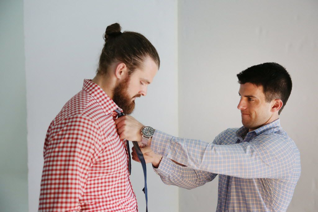 Kevin Lavelle, founder and CEO of Mizzen+Main, places a tie on New Orleans Saints punter Thomas Morstead during a product photography session in Dallas. Lavelle, a Southern Methodist University graduate, started the performance fabric menswear brand in 2012. Morstead is a wearer of and investor in the brand. (Andy Jacobsohn/Staff Photographer)