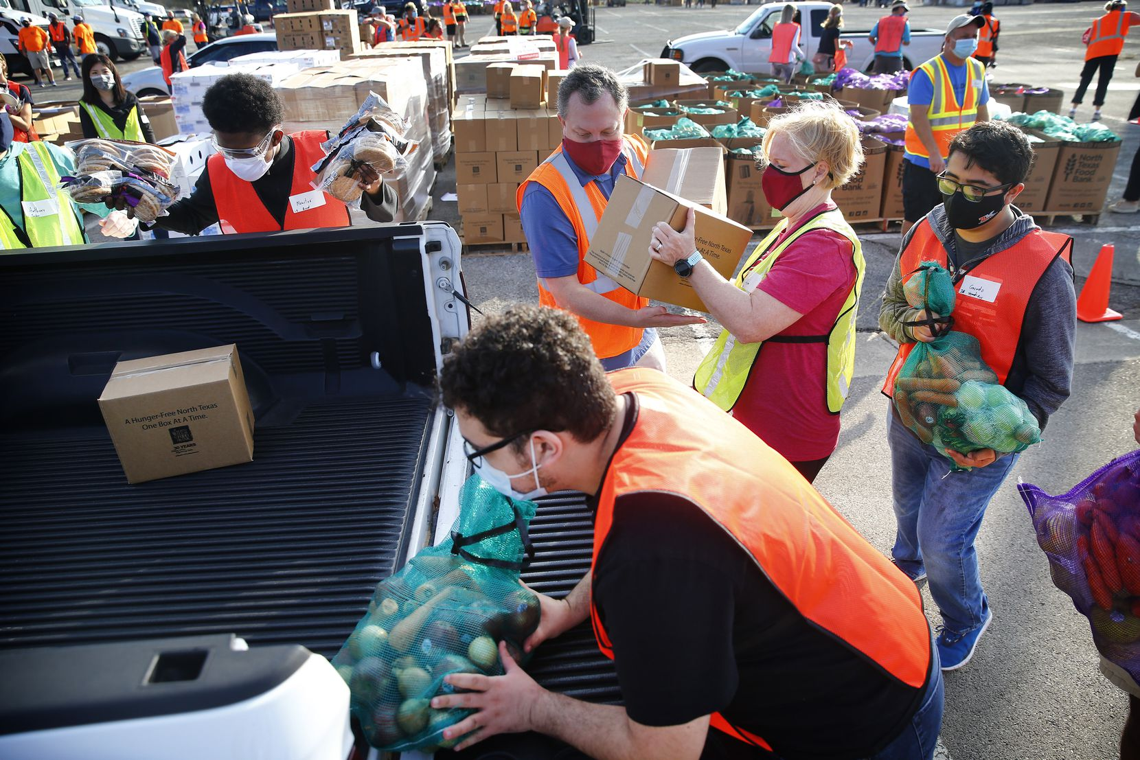 Volunteers loaded up turkeys, fresh produce, bread and non-perishables into families' vehicles during Saturday's distribution at Fair Park. The selection of food was geared toward Thanksgiving.