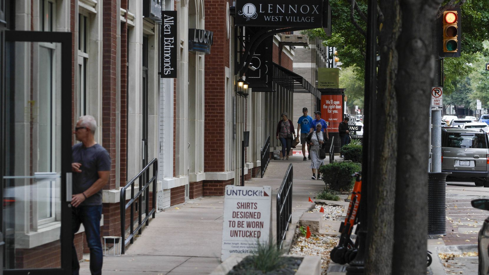 Shoppers wandered into stores and walked down the sidewalk at the West Village in Dallas.