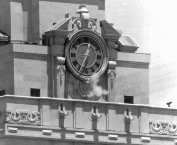 A puff of smoke rises from the University of Texas tower as Charles Whitman fires a shot on Aug. 1, 1966. Whitman, an architectural engineering student and former Marine sharpshooter, killed 14 people and wounded another 31 from the tower's observation deck before an Austin police officer shot and killed him. Whitman had also killed his wife and mother the night before.