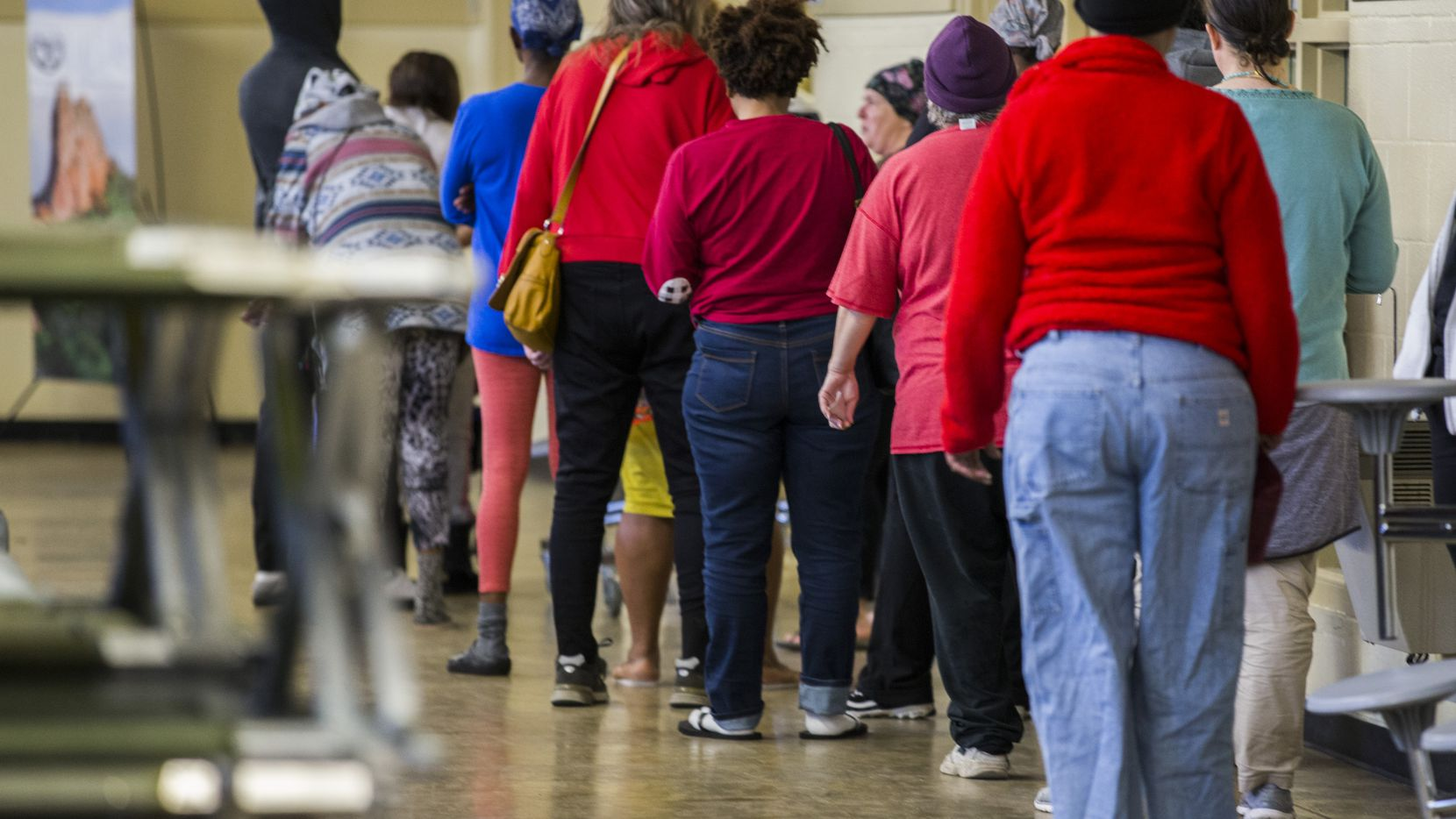 People waited in line for mail at Austin Street Center, which provides shelter and services for the homeless, in Dallas. Irving's inclement weather homeless shelter at Bear Creek Community Church will not open this year due to COVID-19.