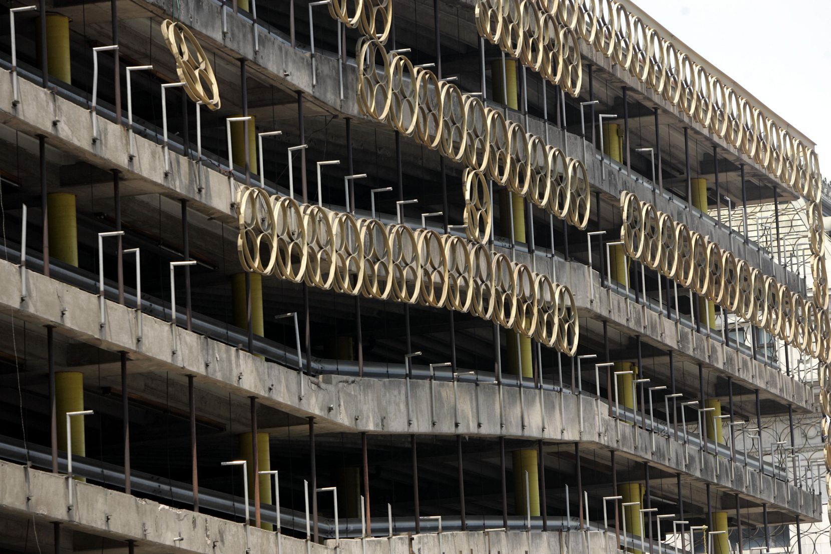 This 2005 photo shows the large rings that decorated a downtown parking garage that was later razed to build Main Street Garden. Some of those rings will be used in a latticework structure in Harwood Park.