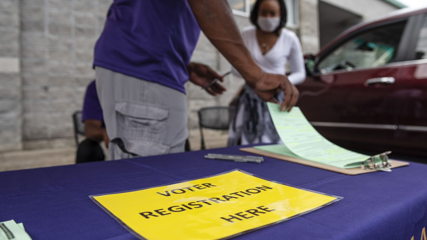 Omega Psi Phi Fraternity, INC, part of the National Pan-Hellenic Council, conducts a voter registration drive outside of the Cash Saver grocery store in south Dallas, Saturday, Sept. 05, 2020. Ben Torres/Special Contributor
