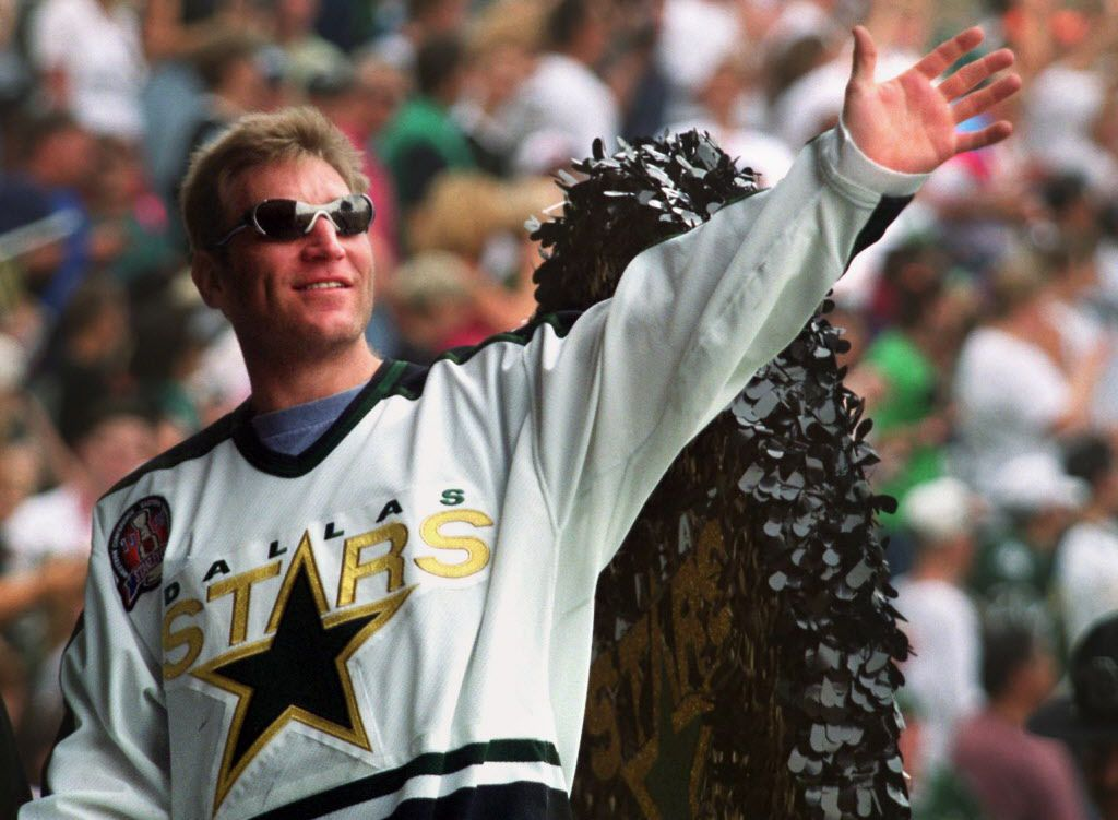 Dallas Stars right wing Brett Hull waves to the crowd during the Stanley Cup Championship Parade on Young Street in Downtown Dallas.