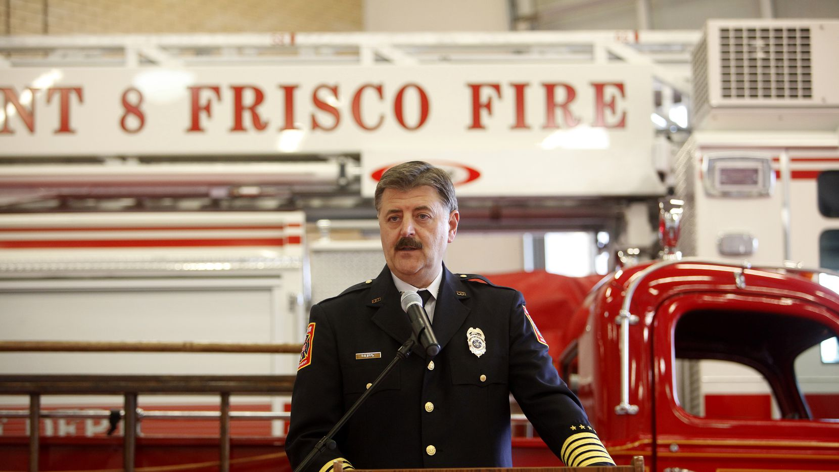 Frisco Fire Chief Mark Piland spoke during celebrations to mark the Frisco Fire Department's 100 years of service in 2014.