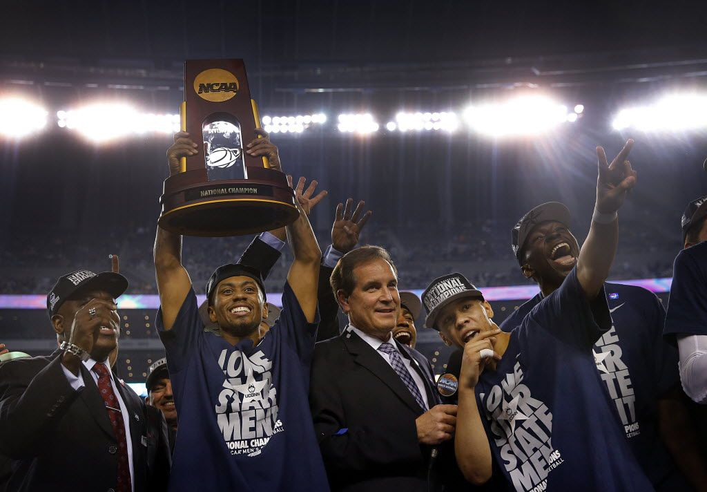 FILE - UConn guard Ryan Boatright (11) raises the championship trophy as teammate Shabazz Napier grabs the microphone from Jim Nantz to say a few words to fans in celebrating their 60-54 defeat of Kentucky in the NCAA tournament final at AT&T Stadium in Arlington on Monday, April 7, 2014. (Tom Fox/The Dallas Morning News)