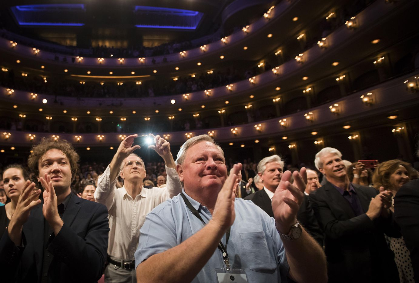 Host Tom Kees applauds the winners with during the Van Cliburn International Piano Competition awards ceremony at the Bass Performance Hall in Fort Worth on Saturday, June 10, 2017. (Smiley N. Pool/The Dallas Morning News)