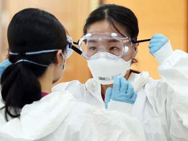 Nurses in South Korea are trained on protective equipment before treating patients who have the COVID-19 coronavirus. Goggles and masks are among the equipment recommended by the U.S. Centers for Disease Control and Prevention.