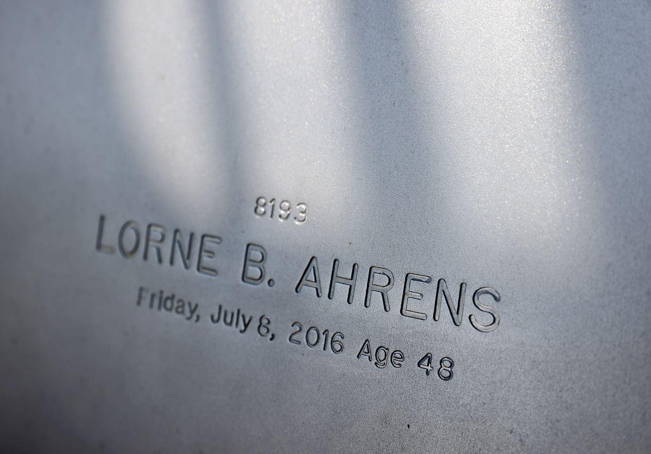 Dallas Police Sr. Cpl. Lorne B. Ahrens' name is etched in the Dallas Police Memorial as seen during the 2021 Police Memorial Day in downtown Dallas, Wednesday, July 7, 2021. It was the 5th anniversary of the July 7th ambush and special recognition was given to those officers, including Ahrens who died a day later.(Tom Fox/The Dallas Morning News)