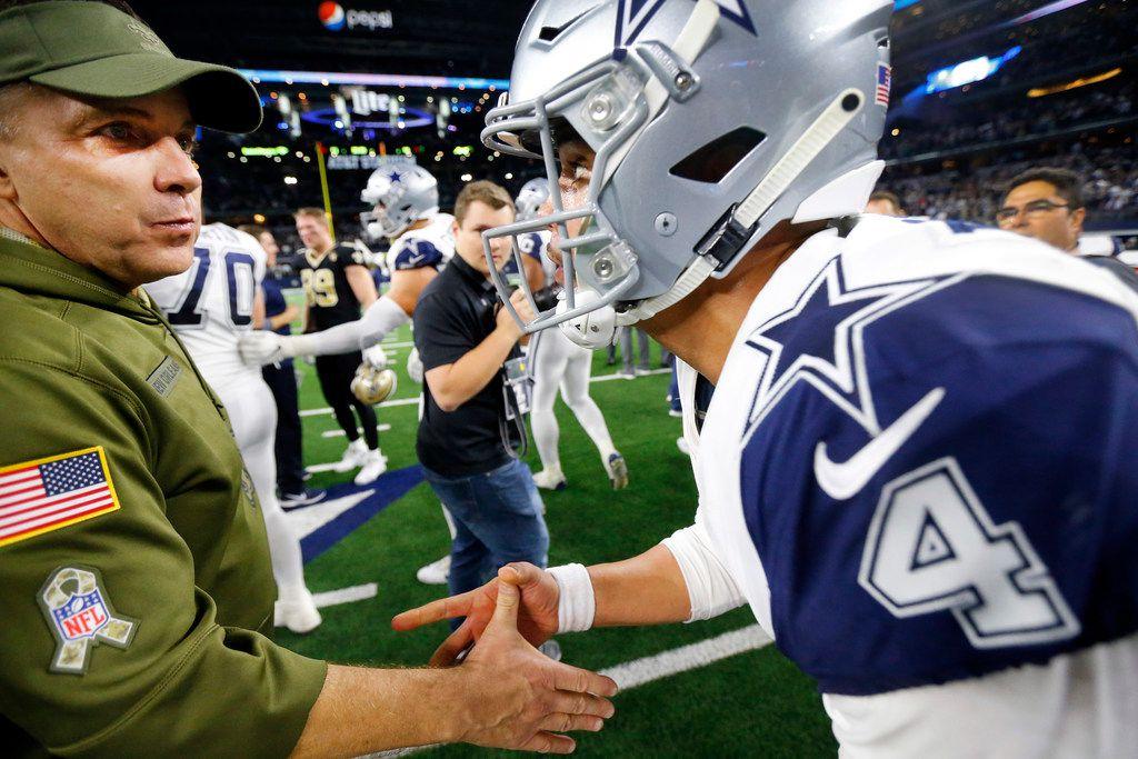 New Orleans Saints head coach Sean Payton congratulates quarterback Dak Prescott (4) on their 13-10 win over the New Orleans Saints at AT&T Stadium in Arlington, Texas, Thursday, November 29, 2018. (Tom Fox/The Dallas Morning News)