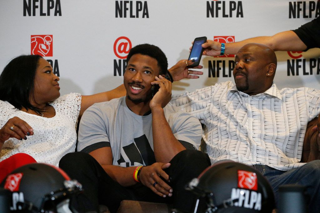Myles Garrett of Texas A&M and Arlington Martin takes a phone call between his mother Audrey and Lawrence Garrett before he is announced the number one draft in the NFL by the Cleveland Browns at Terre Verde Golf Course in Arlington, Texas on April 27, 2017. (Nathan Hunsinger/The Dallas Morning News)