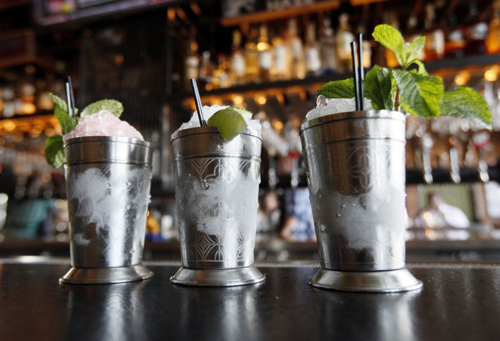 A trio of juleps (from left): Family Reunion with watermelon, Aperol and white whiskey;  Margarita's Julep with reposado tequila, lime, agave and orange bitters; and a Traditional Julep.