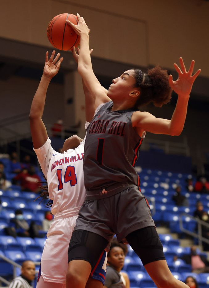 Cedar Hill's Jadyn Atchison (1) blocks a shot attempt from Duncanville's Kaila Kelley (14) during the first half of play at Sandra Meadows Arena at Duncanville High School on Tuesday, January 12, 2021 in Dallas. (Vernon Bryant/The Dallas Morning News)