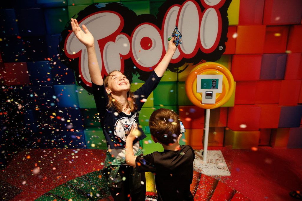 Abigail Corder, 11, and her brother Peyton Corder, play in confetti at Candytopia, an immersive pop-up art exhibit, in Dallas on Thursday, April 4, 2019.  (Rose Baca/Staff Photographer)