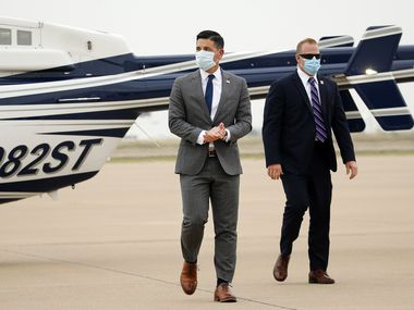 Acting Secretary of Homeland Security Chad Wolf (left) gets off a helicopter after receiving an aerial tour around the Alliance Airport area in Fort Worth by Ross Perot, Jr (not pictured), Thursday, May 21 2020.