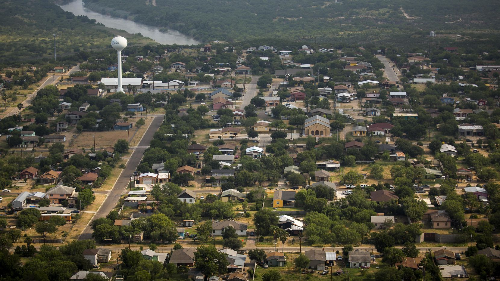 """An aerial view shows the city El Cenizo, Texas,  on the banks of the Rio Grande on Thursday, May 11, 2017. The small town (population 3,800)  has had  a """"safe haven"""" ordinance in place since 1999, and has become the first to legally challenge the Texas sanctuary cities ban."""