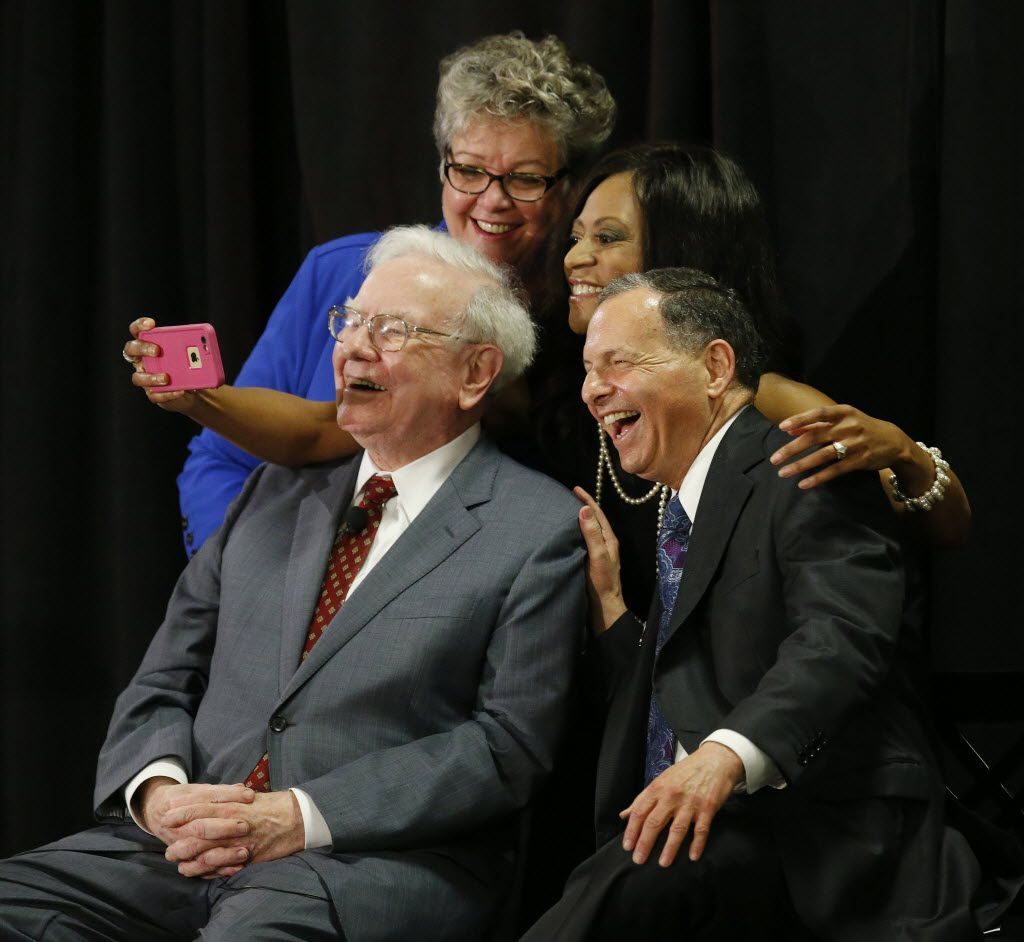 Mirchelle Louis (top left), CEO of Cancer Support Community North Texas, Deanna Dewberry (top right), an NBC 5 consumer investigative reporter, Warren Buffett (bottom left), the CEO of Berkshire Hathaway, and Irv Blumkin (bottom right), CEO of Nebraska Furniture Mart, take a selfie together during the Live Big Benefit for Cancer Support Community North Texas benefit at Nebraska Furniture Mart in The Colony in 2015.