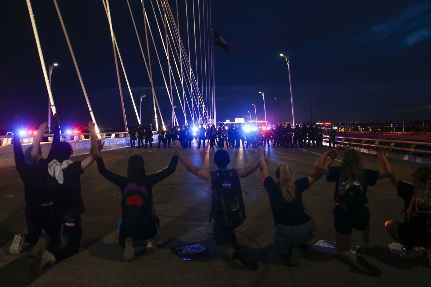 Protesters march onto the Margaret Hunt Hill Bridge as the demonstrate against police brutality on Monday, June 1, 2020, in Dallas. Later on, the hundreds of protesters were surrounded and detained by police.