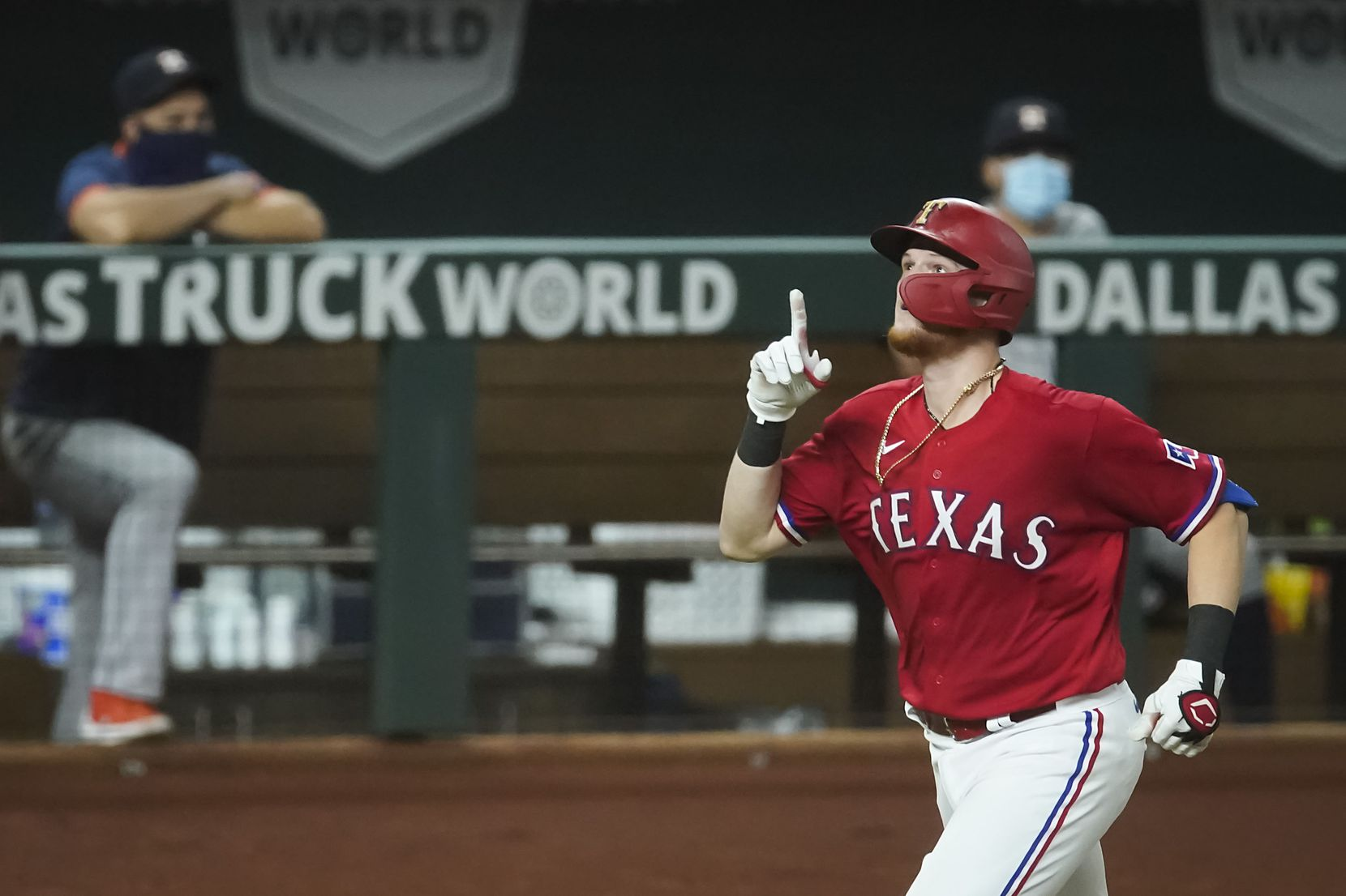 Texas Rangers catcher Sam Huff celebrates as he rounds the bases after hitting a solo home run off of Houston Astros pitcher Jose Urquidy during the fifth inning at Globe Life Field on Friday, Sept. 25, 2020.