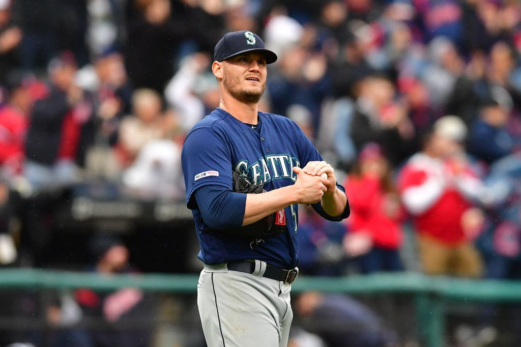 CLEVELAND, OHIO - MAY 04: Connor Sadzeck #54 of the Seattle Mariners reacts after giving up a two run home run to Carlos Santana #41 of the Cleveland Indians during the eighth inning at Progressive Field on May 04, 2019 in Cleveland, Ohio. The Indians defeated the Mariners 5-4.  (Photo by Jason Miller/Getty Images)