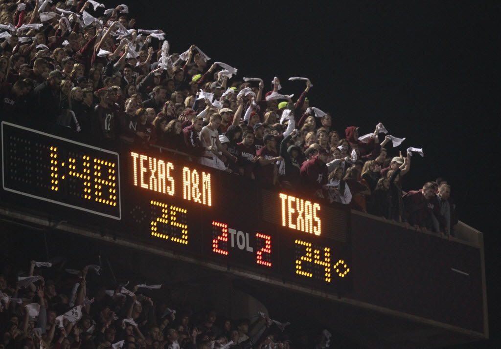 Texas A&M fans cheer as the held a lead during the second half of their Thanksgiving day game at Kyle Field in College Station, on Thursday, November 24, 2011. It is the last Big XII football game between the Texas Longhorns and the Texas A&M Aggies. Texas won 27-25. (Michael Ainsworth/The Dallas Morning News)