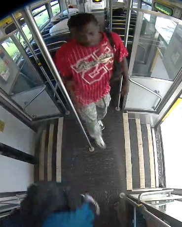 A still image of a suspect wanted in connection with a fire set aboard a DART train on Sunday, July 12, 2020, from images released by Dallas fire officials. The blaze left a passenger burned.