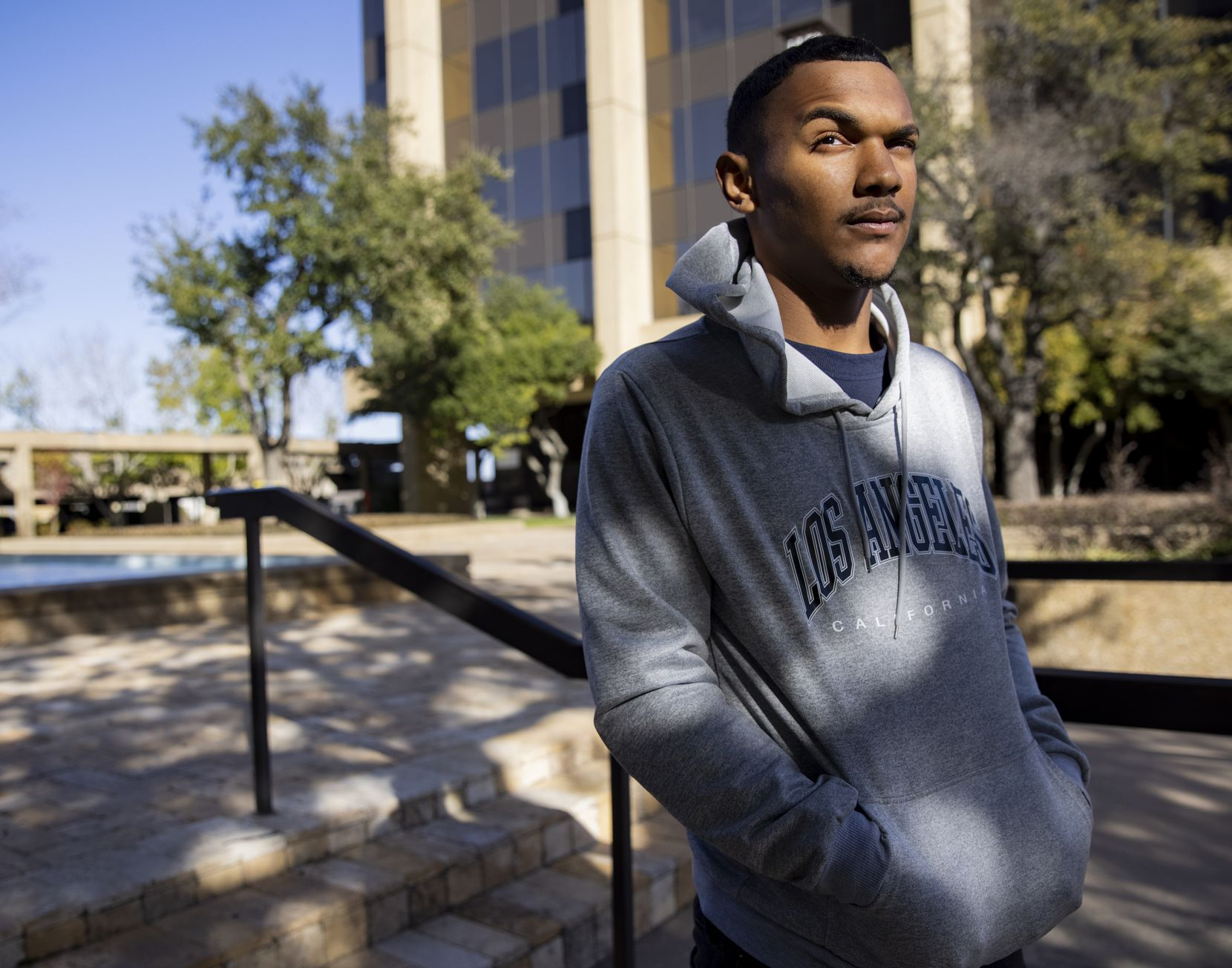 Neco Bonham, 18, posed for a photo outside of the law office of Damon Mathias in Dallas on Jan. 15. Bonham is suing Richardson police in federal court for racial profiling and excessive force.