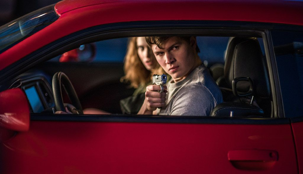 """Baby (Ansel Elgort) and Debora (Lily James) jack a car to get away in the action movie, """"Baby Driver."""" Baby's feelings are inextricably linked to his rapid-fire, unconventional listening habits that make the movie so alluring. We are on a ride of Baby's own making, listening to his playlist as he assembles it in real time."""